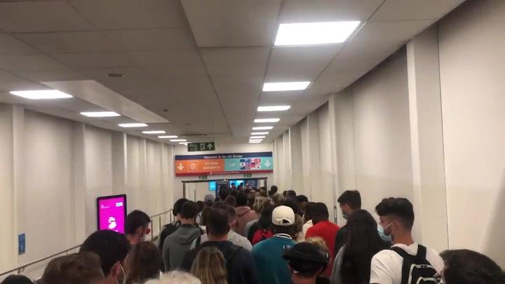 Massive queues at London Luton airport amid huge delays