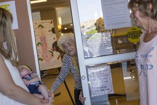 Great-grandmother meets great-granddaughter through window