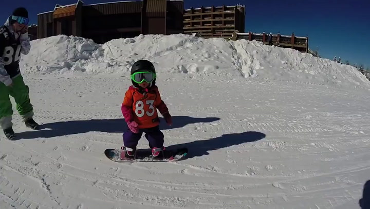 16-month-old snowboards at Breckenridge
