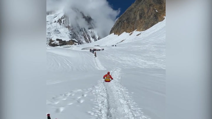 Double amputee uses arms to propel himself up Himalayan mountain