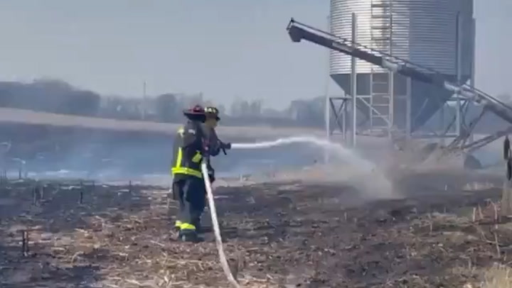 Indiana firefighters battle wind-fueled grass fire