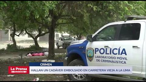 Hallan un cadáver embolsado en carretera vieja a La Lima