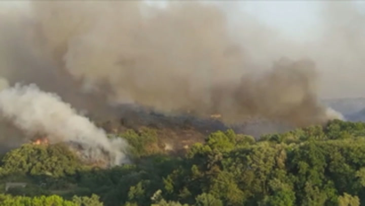 Firefighters bring wildfires under control as they continue to battle flare-ups in Italy