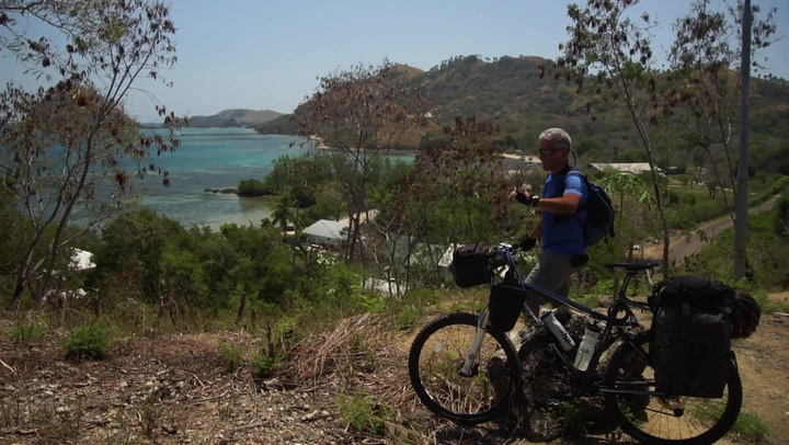 bde0ed2ea Third part of Michele s bike trip across Flores Island - Indonesia. From  Ruteng to Labuan Bajo. Michele continues to cycle on hard climbs on this  tropical ...