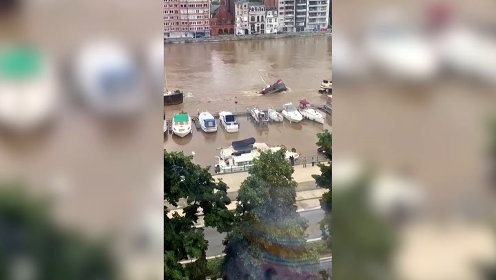 Moment barge sinks as river nearly bursts its banks in Belgium