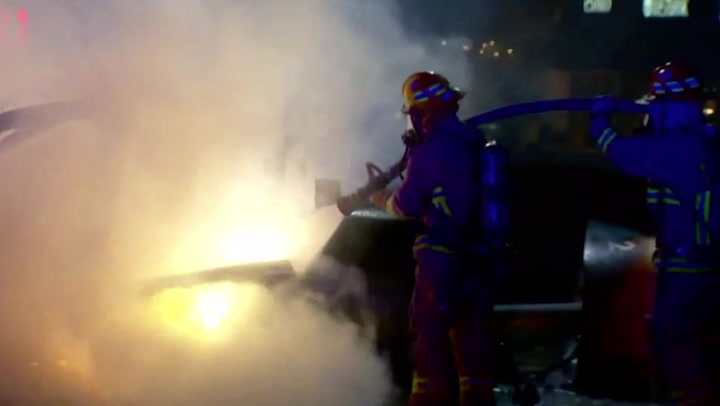 Tesla crashes into petrol pump and bursts into flames after battery explodes