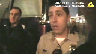 Las Vegas police talk with Jason Aldean's manager outside his bus on Oct. 1