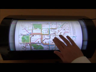 UK co intros curved touch display sensor with 10-pt multitouch