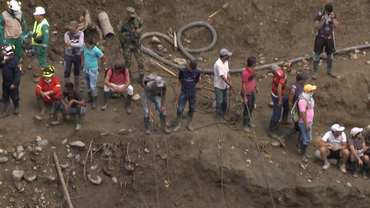 After 22-day search, rescuers find bodies of miners trapped by flooding