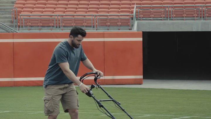 Image result for baker mayfield mowing lawn