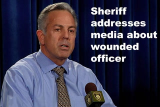Sheriff addresses media about wounded officer