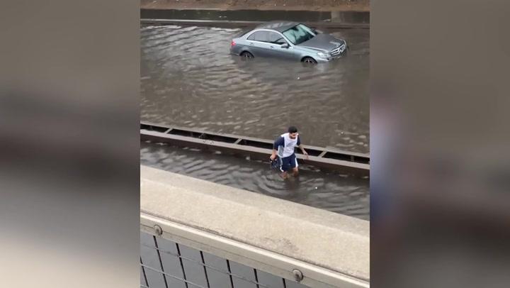 Driver abandons car as heavy floods hit London