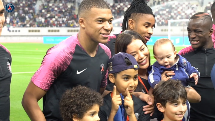 Kylian Mbappé Cradles A Baby At PSG Training