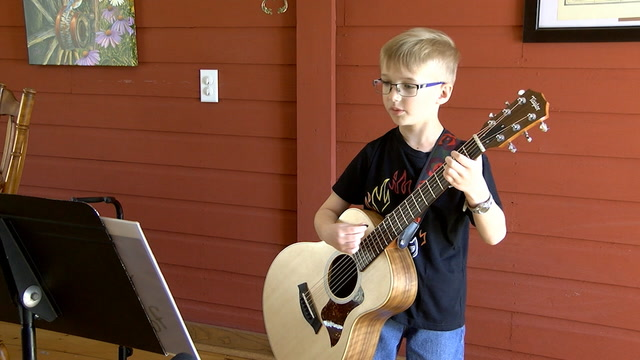 A pint-sized North Dakota farmer and singer is brightening people's day by recording and sharing concerts from his living room.