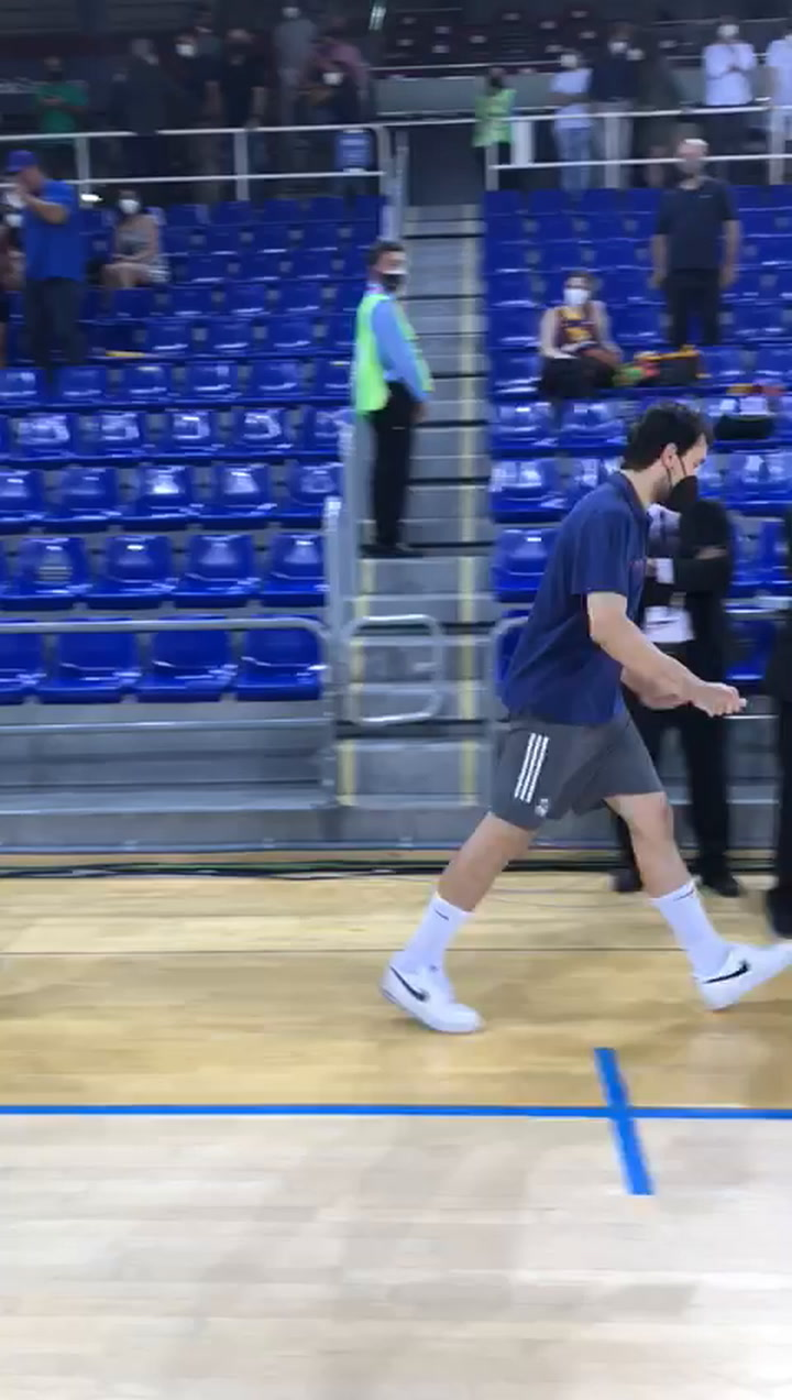 Pau Gasol and Sergio Llull greet each other after finishing the final