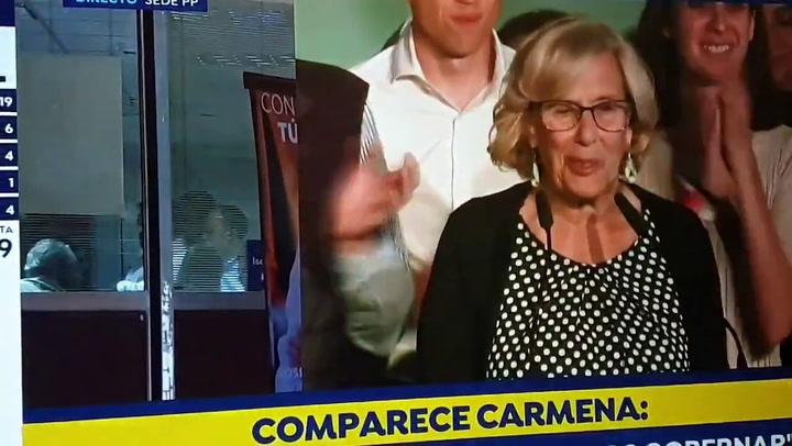 Corte de mangas desde la sede del PP ante las palabras de Manuela Carmena