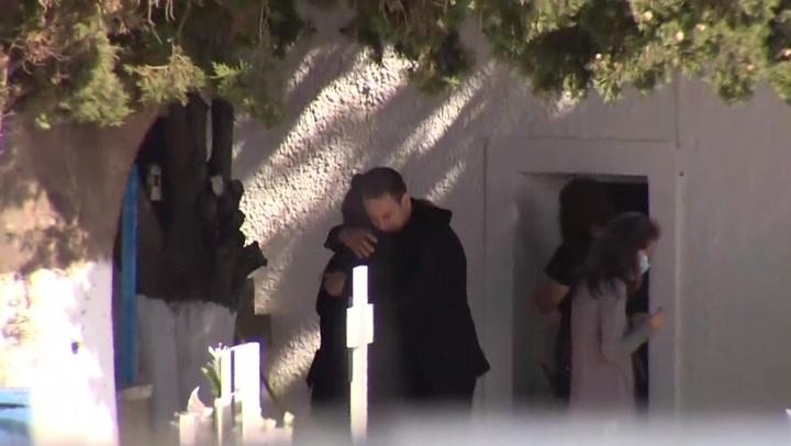 Greek pilot arrested over wife's death hugs victim's mother