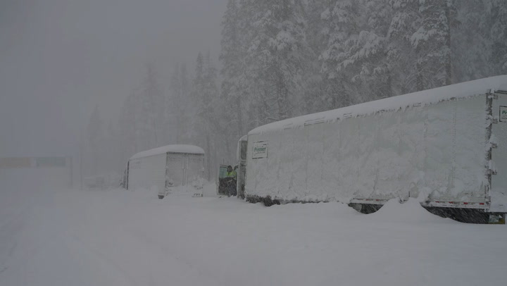 Feet of snow causes a travel nightmare in the Sierra Nevada