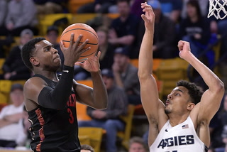 UNLV's Marvin Menzies on point guard Amauri Hardy