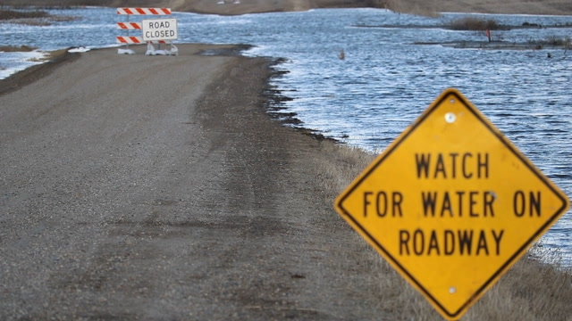 The flooding of rural roads is an especially big problem this year, making it difficult for farmers to get into their fields.