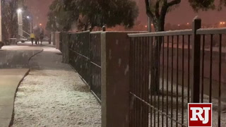 Snow falls Wednesday evening in Las Vegas