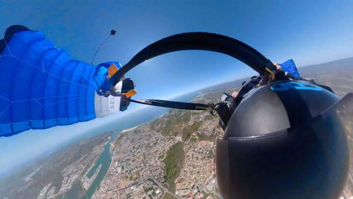 The Terrifying Moment A Wingsuit Pilot's Parachute Tangles On Descent