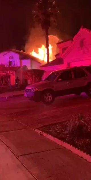 Crews battle house fire on Glass Lantern Drive in North Las Vegas