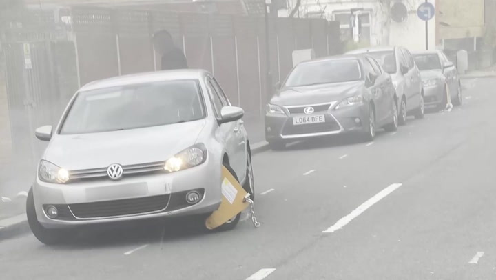 Motorist tries to drive away with clamp attached to wheel