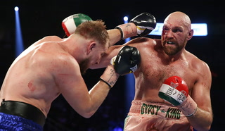 Tyson Fury survives being cut over his eye to outlast Otto Wallin