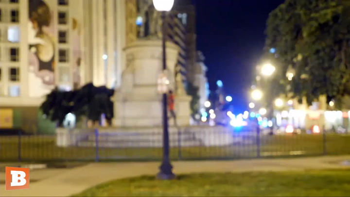 Protester Scampers Away When Cop Approaches Him for Climbing D.C. Statue