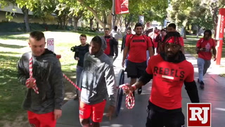 UNLV's football players painted the Fremont Cannon red in celebration to their victory against Reno.