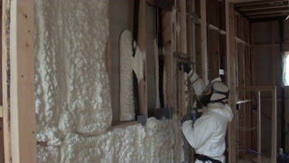 Spray foam insulation at the Proud Green Home at Serenbe