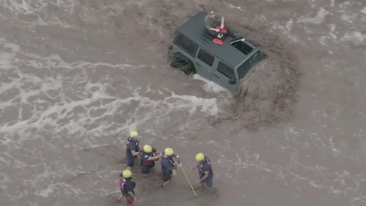 Family rescued from car roof during rapid-moving flood in Arizona