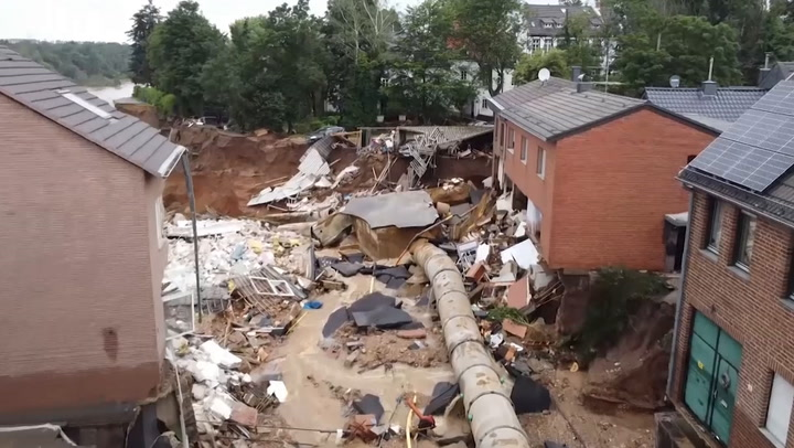 Deadly floods leave giant sinkhole in German town