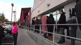 Las Vegas workers line up at career center after layoffs