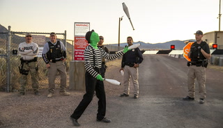 Alien juggles at Area 51 gate