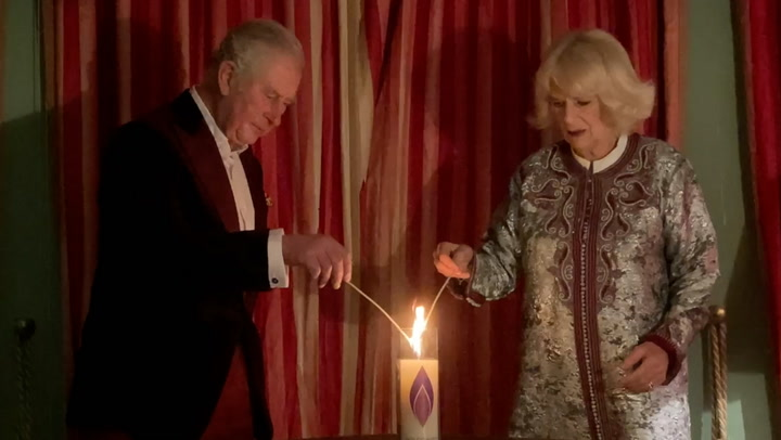 Charles and Camilla lead tributes as they light candles to mark Holocaust Memorial Day
