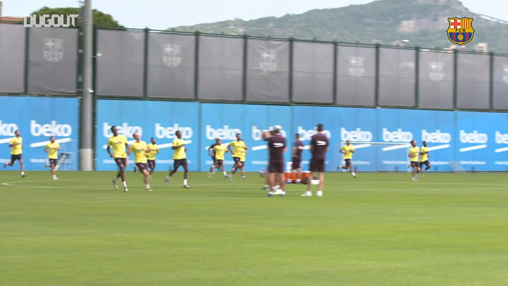 Dembélé back at work on training ground