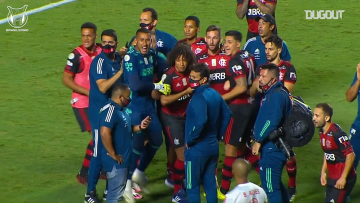 Flamengo players gather around the phone before being crowned champions