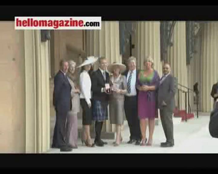 Sir Chris Hoy and his mum honoured at Buckingham Palace
