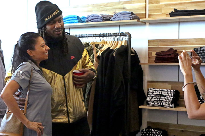 f1b578c31909a Marshawn Lynch celebrates grand opening of his Las Vegas store with fans  and family