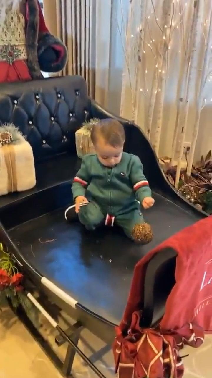 Eva Longoria's son Santi refuses to get out of Santa's sleigh in hilarious video