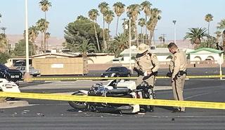 Las Vegas motorcycle officer injured in crash