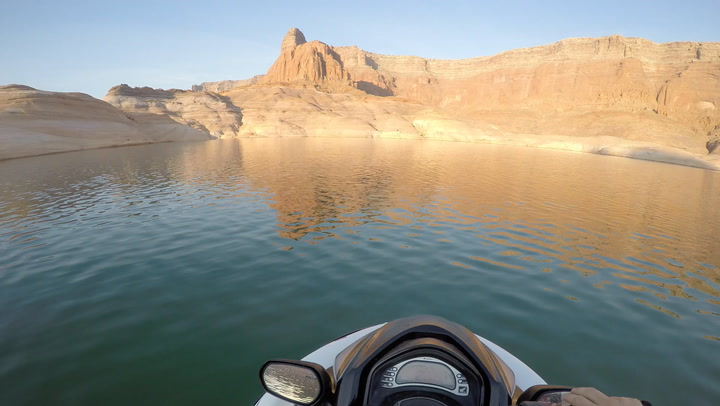 Jet Skier Effortlessly Swerves Through Tight Utah Canyons At High Speed