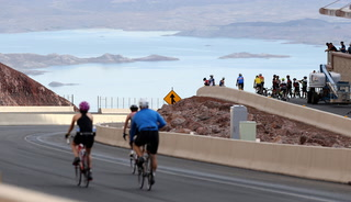 Bicyclists ride empty Interstate 11 before it opens Aug. 9