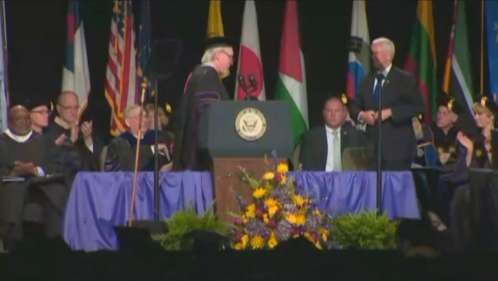 Dozens of graduates walk out in protest of Pence address