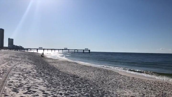 Sunshine and wind greet beachgoers in Alabama