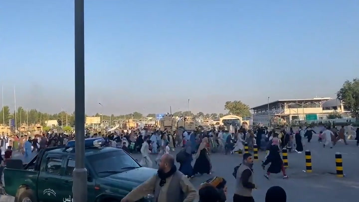 Crowds swarm Kabul Airport as desperate Afghans attempt to flee Taliban