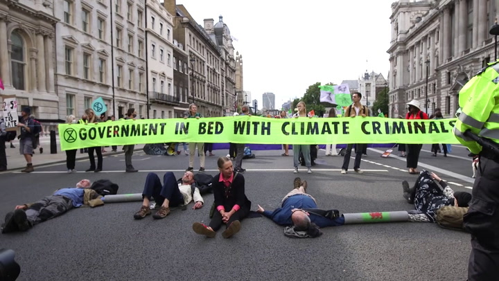 Extinction Rebellion protesters lie on street to block traffic at London demonstration