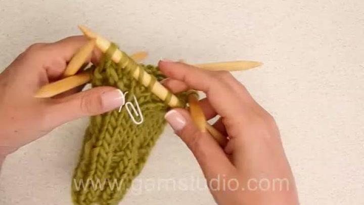 Hvordan lage tommel på en strikket vott